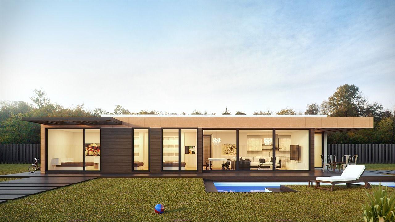 Ein Haus mit Flachdach, Pool und Garten